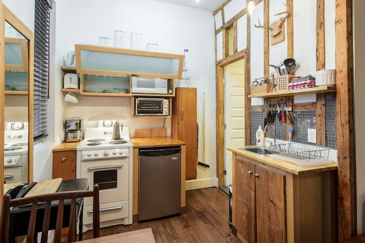 compact kitchen with coffee maker, toaster, toaster oven, kettle, stovetop espresso maker etc.