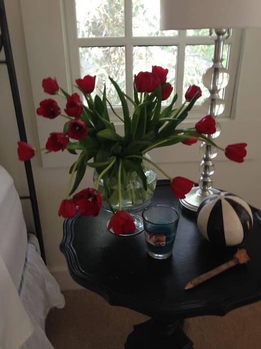 Bedside table with tulips.
