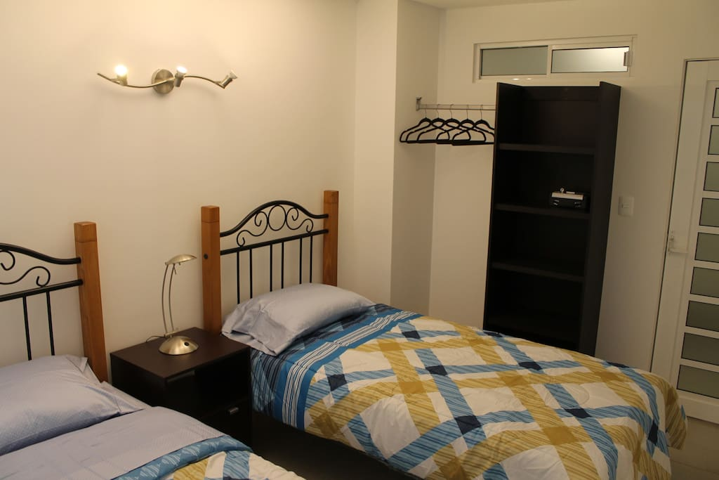 2 singles bed with security box room