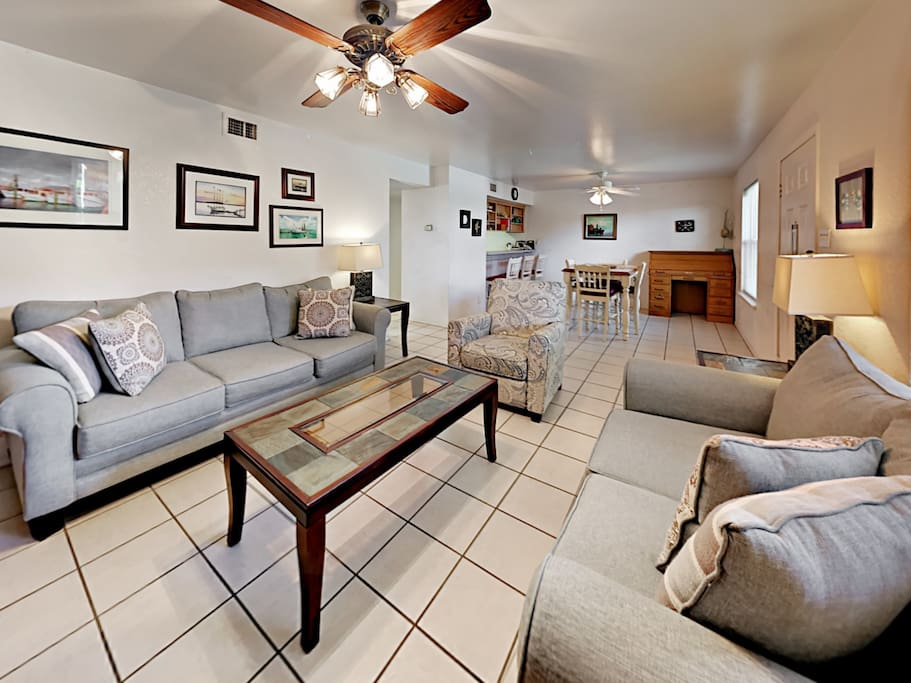 Stretch out on a sofa and matching love seat in the living room.