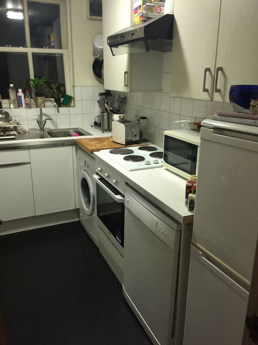Kitchen washing machine dishwasher fridge freezer microwave oven and hob