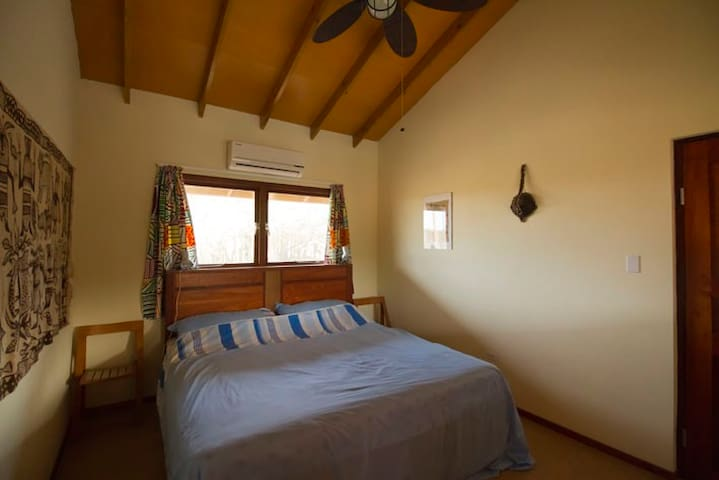 Comfortable bedroom with double bed in Apartment