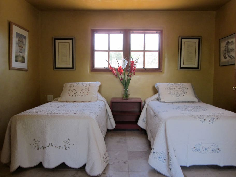 twin beds with heated travertine stone floors.