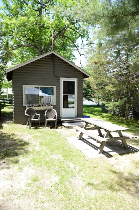 Cabin outside with chairs, picnic table and use of bbq
