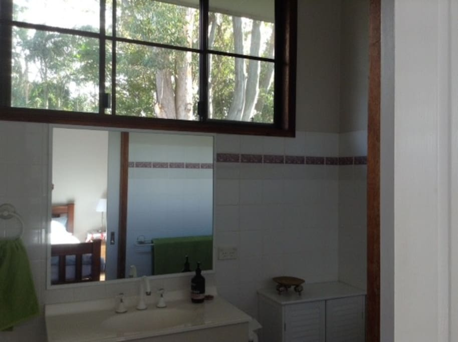 The ensuite bathroom with view of the trees