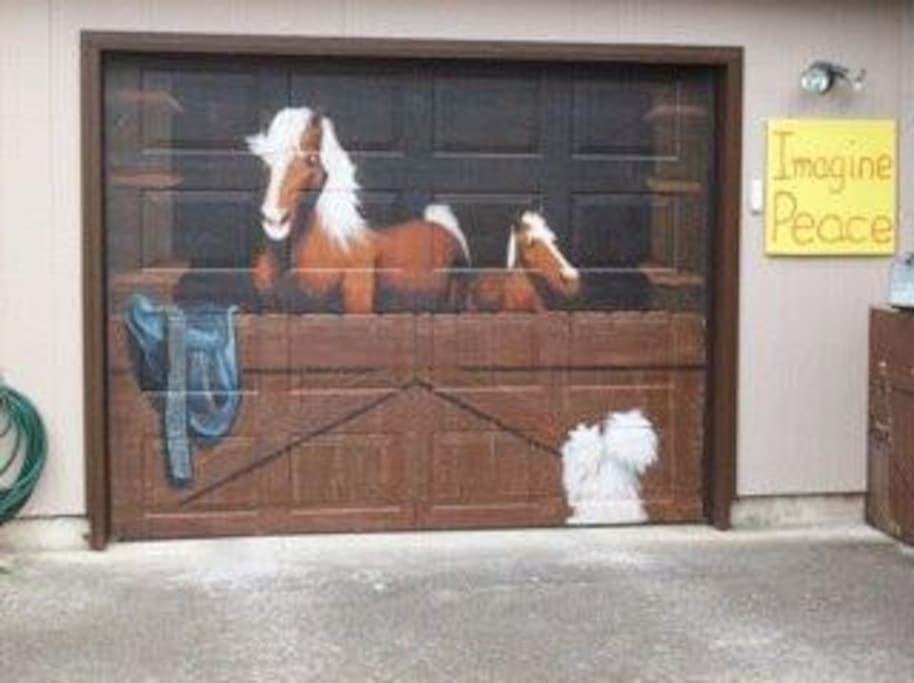 Your private parking space is to the left of this beautiful garage door.