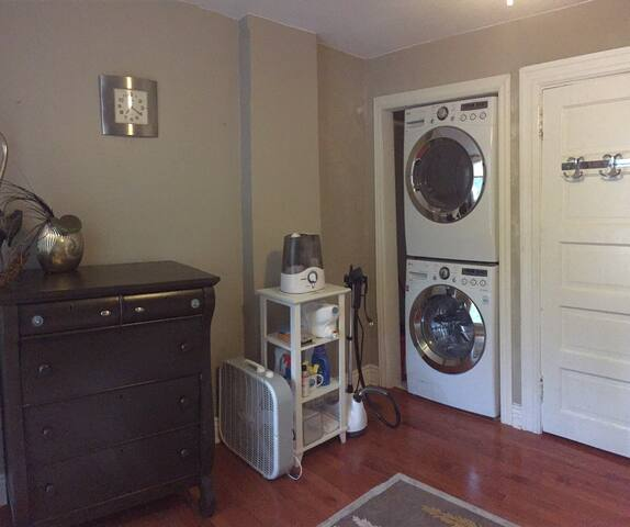 Washer and Dryer units upstairs with clothing steamer, humidifier and fan for use.