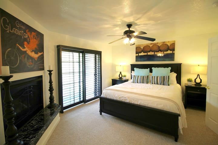 Upper Level: Bedroom 2 has a California King bed and full private bathroom.