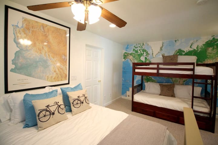 Upper Level: Open perch on landing. Bunk beds and Queen bed. No doors or privacy.