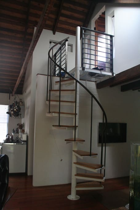 Staircase leading to bedroom loft