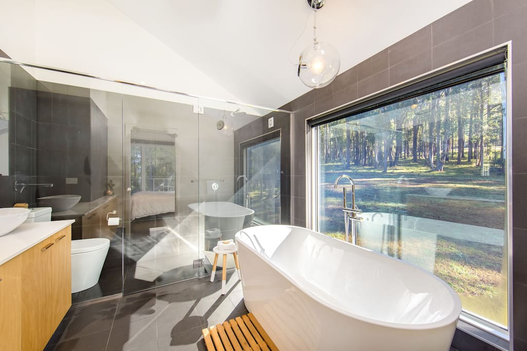 Sooth sore muscles in the ensuite bath and enjoy the view