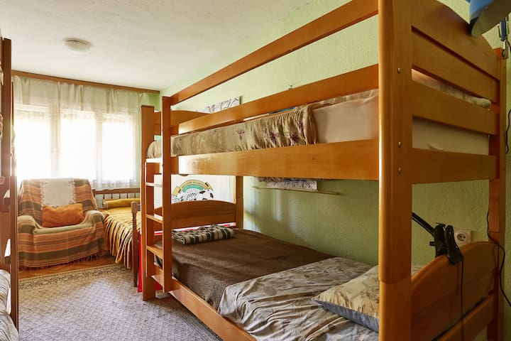 Bed in a dorm room for five in the hills