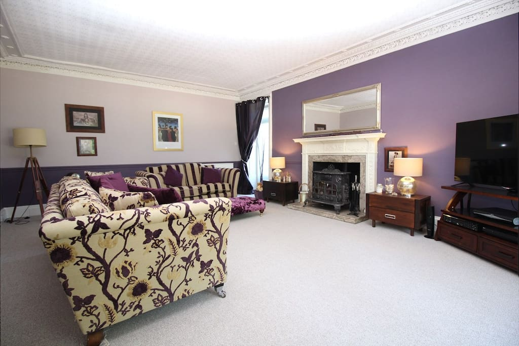 Main Sitting Room with Full Sky TV Package and Wood Burning Stove