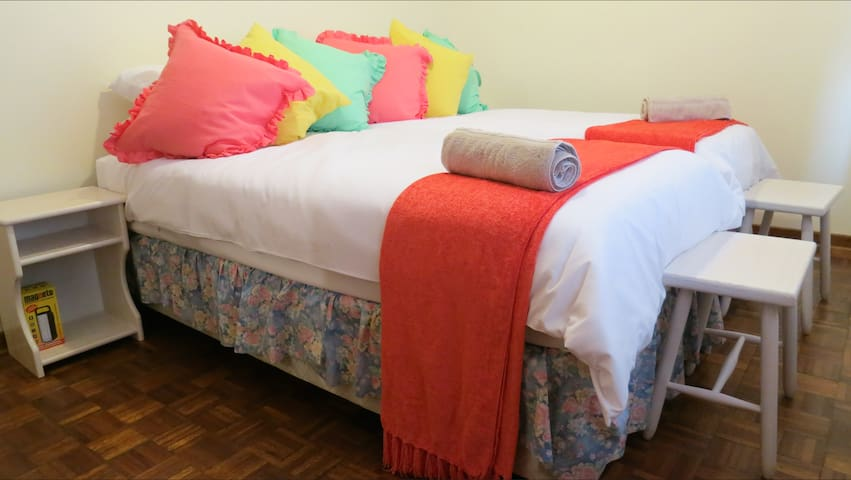 Third bedroom has 2 single beds. Built in cupboards, dresser with mirror and air-conditioner.