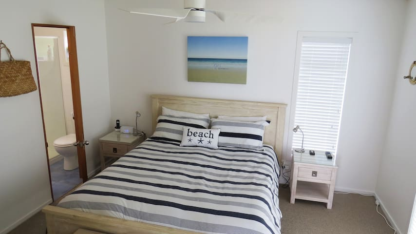 New comfy King bed with ensuite bathroom, TV, phone, outdoor access and sea views