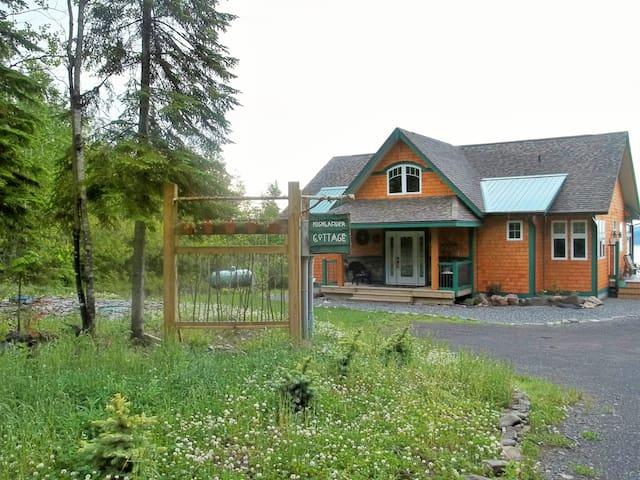 Back side of cottage with side deck.
