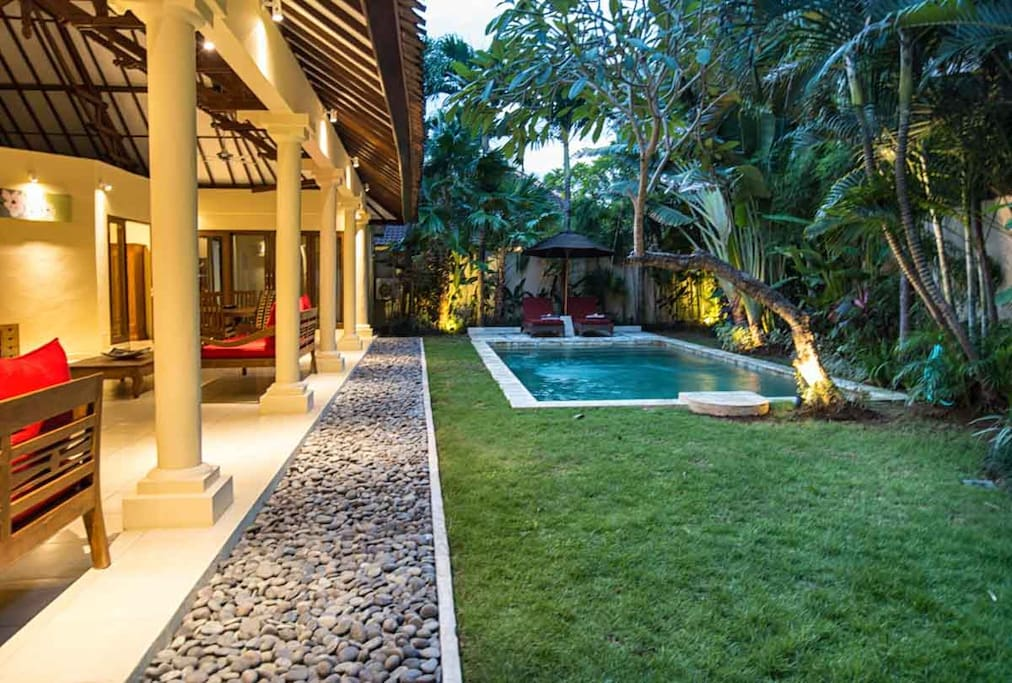 Very well maintained gardens and swimming pool in front of the living room.