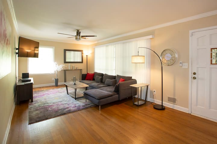 Spacious living room with 4K flatscreen television