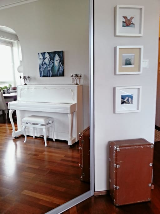 There's a piano for musicians in the living room