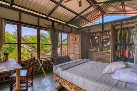 Surrounded by jungle - canopy top cabin