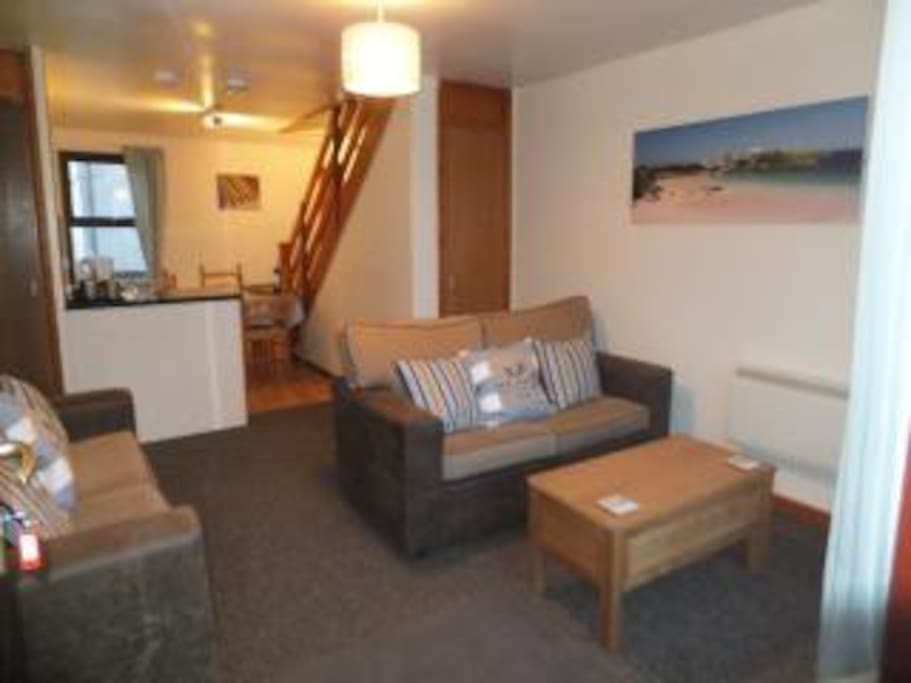 OPEN PLAN LOUNGE/ KITCHEN AREA   -   LCD  tv,   dvd + freeview