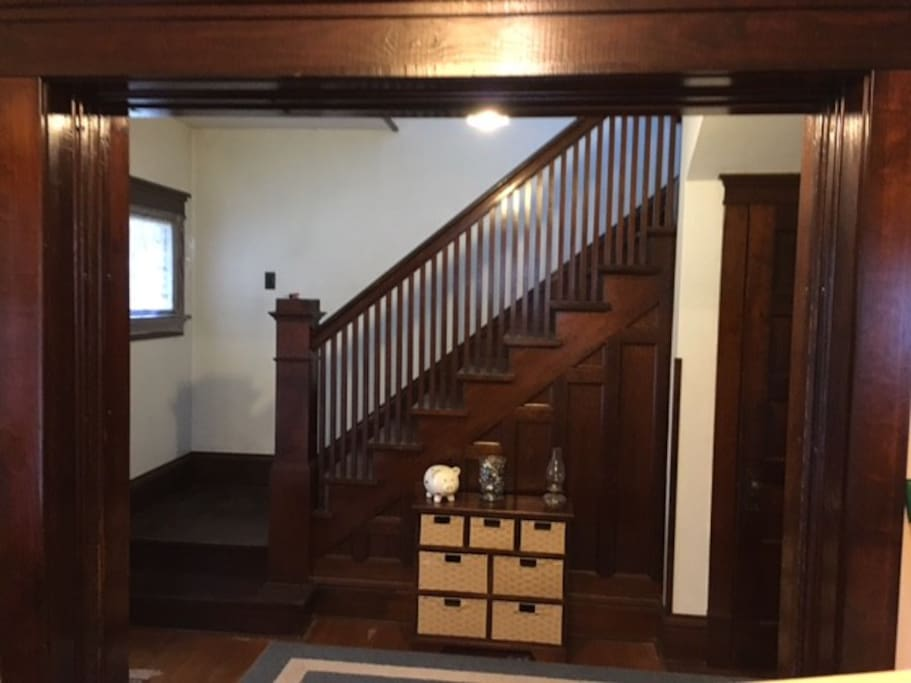 The entryway and stairs going up to the bedroom.