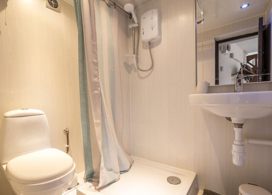 Bathroom with electric power shower.