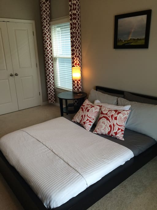 Full bed in large guest room.