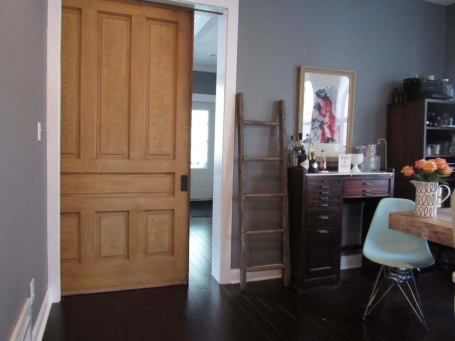 Favorite detail in the house is the historic seven panel pocket door that separates the living room from the dining room.