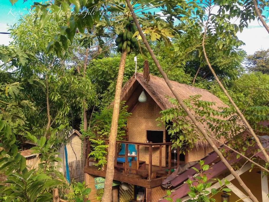 The Loft at Kupu Kupu Cottages is a room with a tropical garden view.