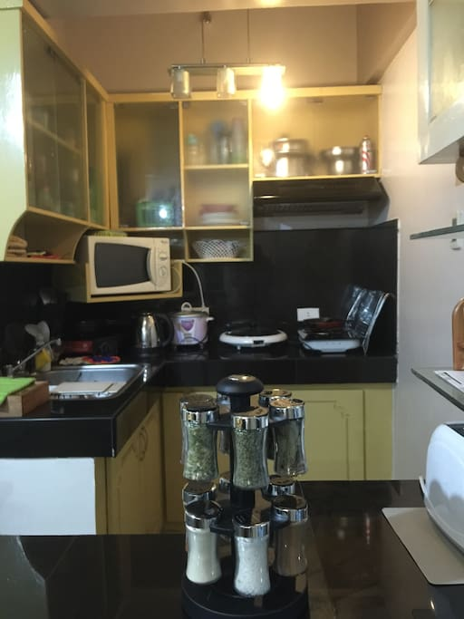 Kitchen (microwave, electric stove, butane gas stove, kettle, rice cooker, utensils, refrigerator)