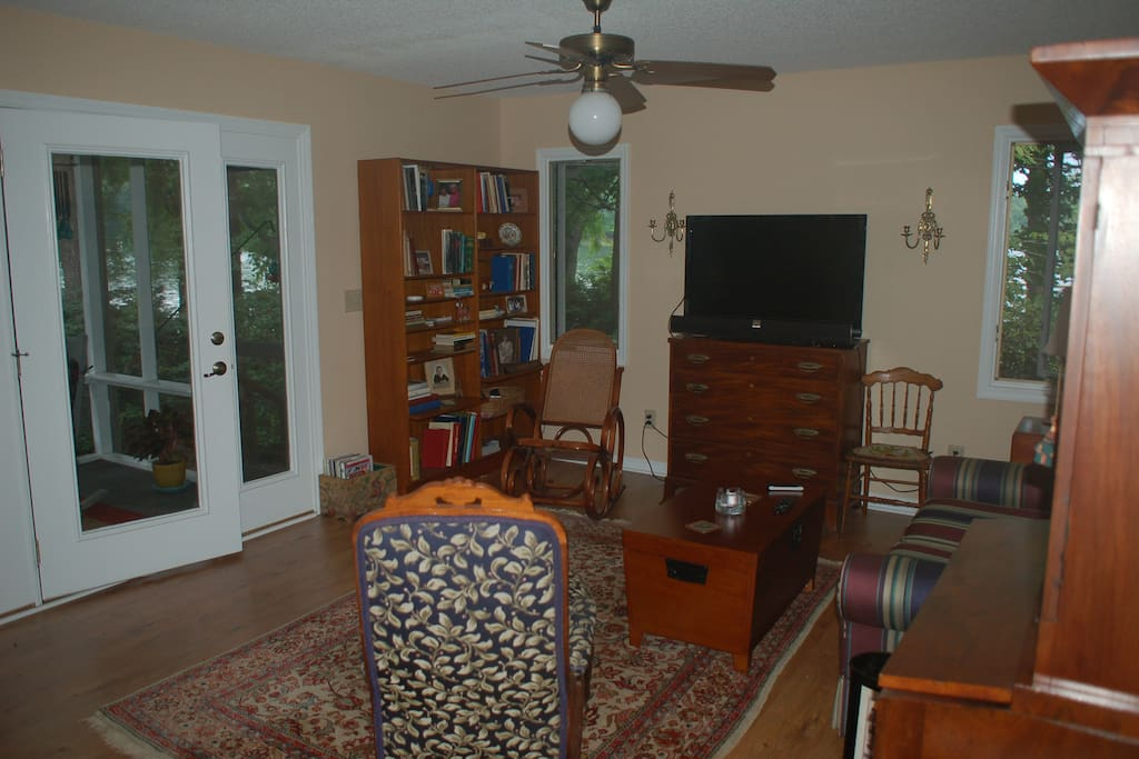 Living room with view of door to screened porch