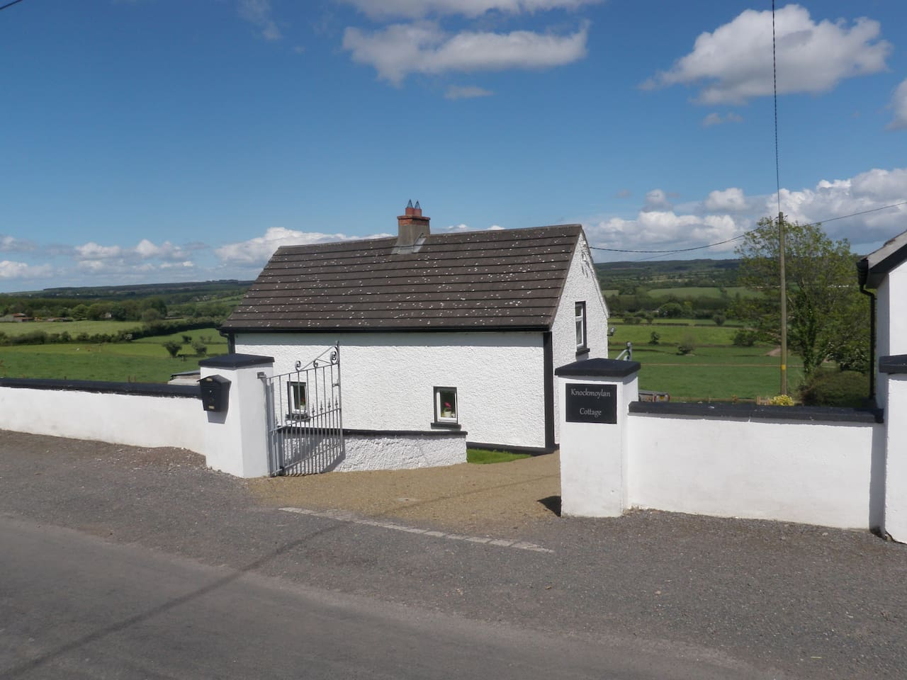 View of the cottage from roadside.
