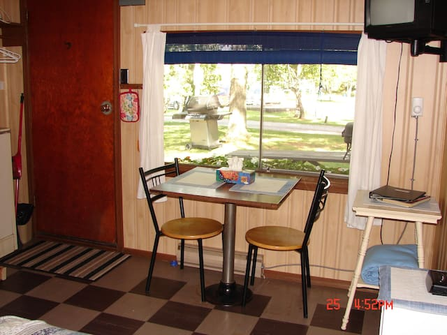 Dining table, small TV, double bed