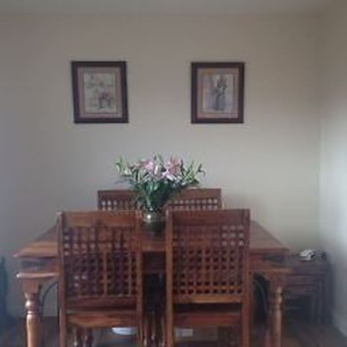 4 seater large dining table with extra sets available