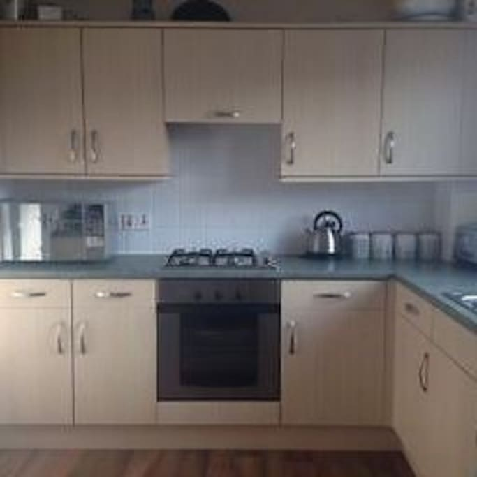 Bright and spacious kitchen with full use of kitchen utensils.