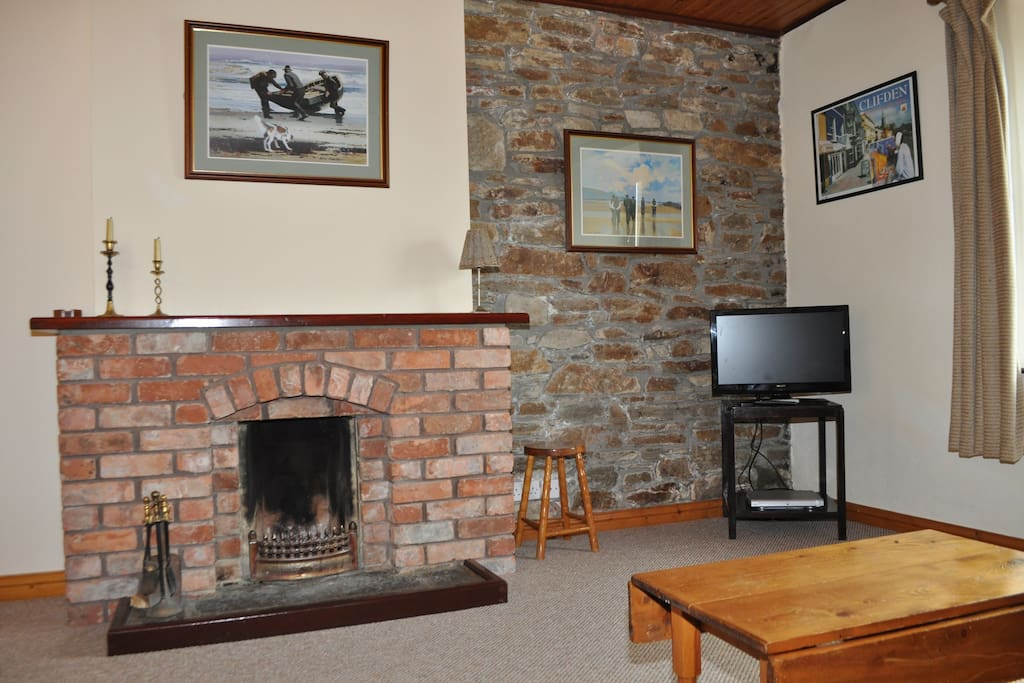 Open fireplace and TV