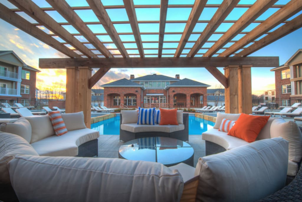Resort-style pool and sundeck with cabanas