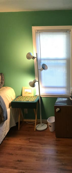 Bed stand with lamp, 5 outlets just below table to plug in all of your electronics.