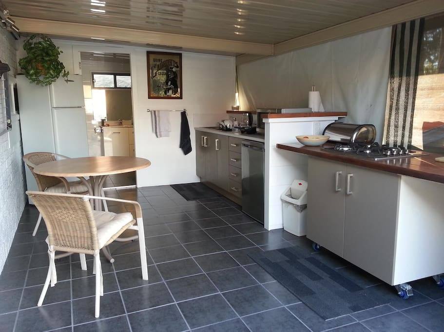 New open-air kitchen with views over yard, or ability to drop down blinds if preferred