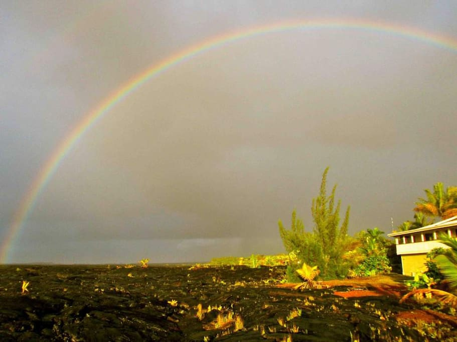 Our home is out on a lava flow -- dramatic black lava fields, rainbows and open sky, and a frontrow seat to Pele's molten flow..