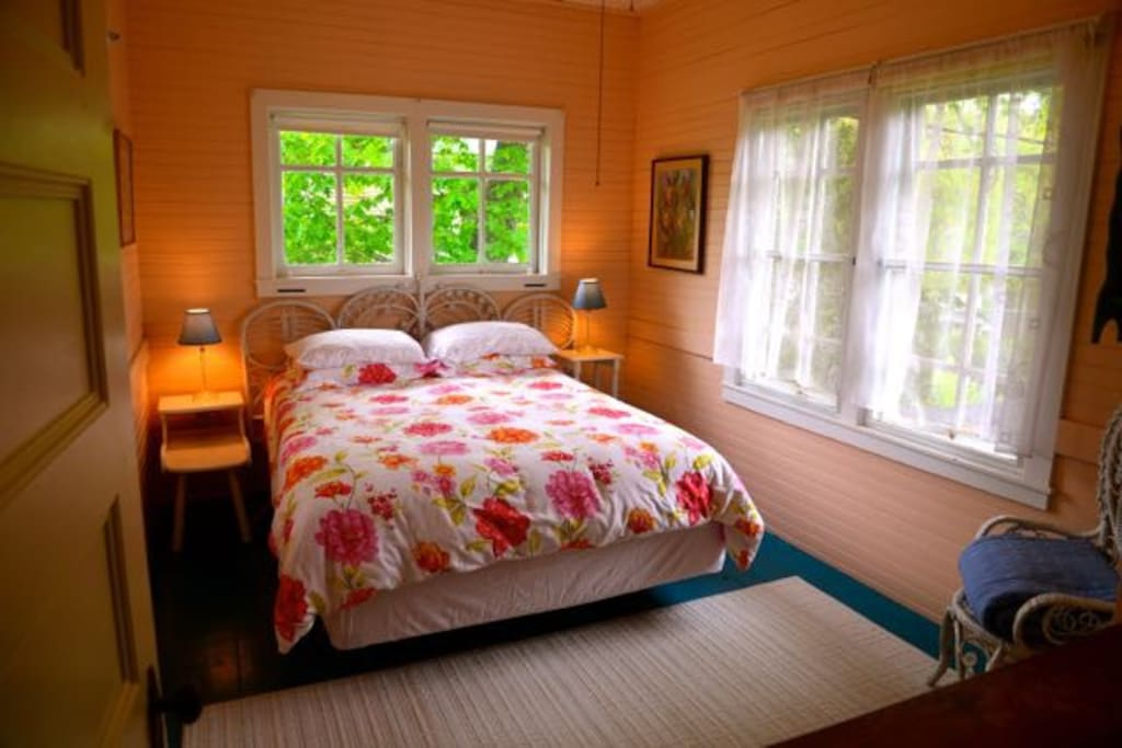 Comfy bedroom with queen bed and lots of light.