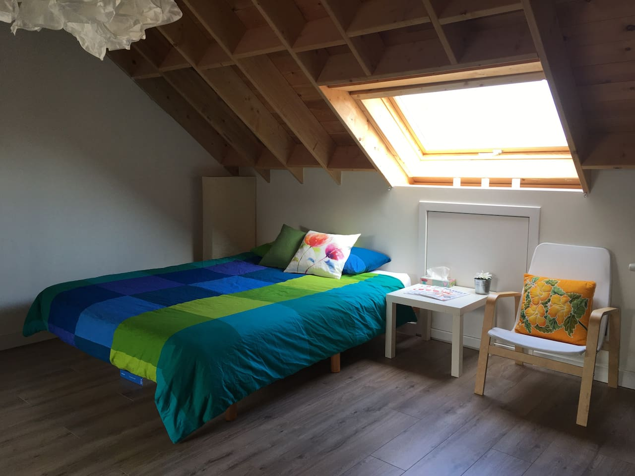 Queen-size bed and skylight