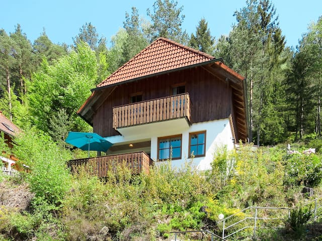 Lovely holiday house with large balcony, in a hilly location with wonderful views