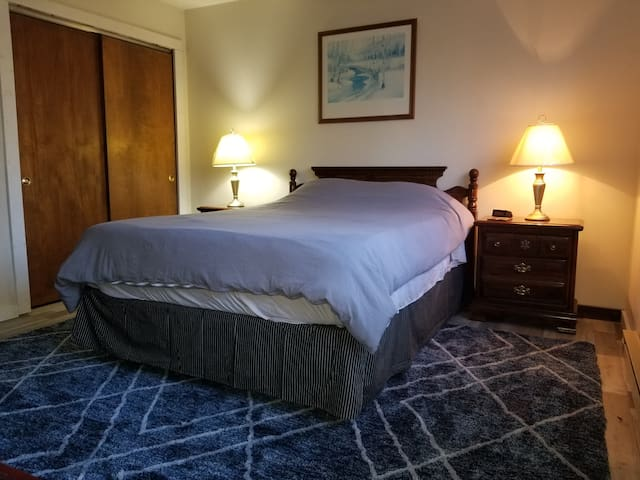 Upstairs bedroom contains a queen bed, toddler bed a small roku smart TV, and brand new luxury flooring throughout