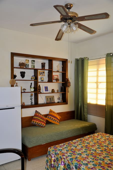 The bedroom has a fridge, a Safe and additional personal bed.