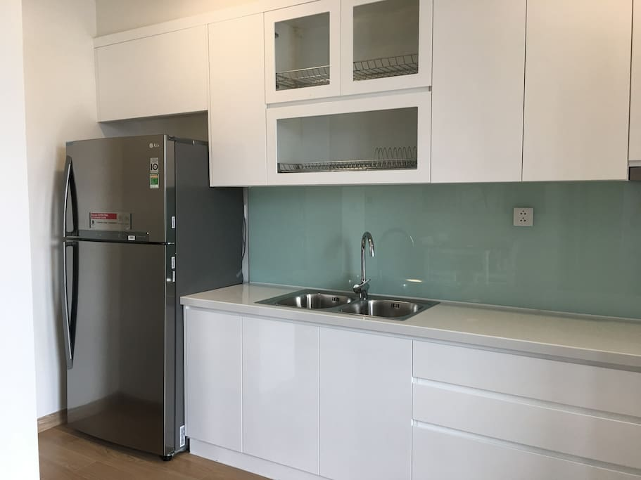 Kitchen with induction, hood, refrigerator