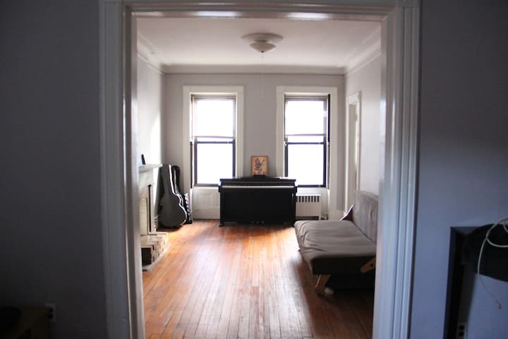 Huge private bedroom in sun-soaked UES apartment