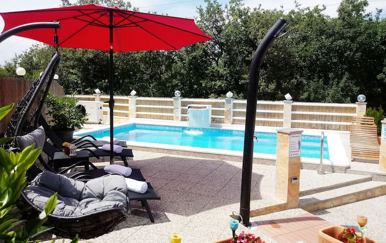 (NEW PHOTO) SPEND YOUR TIME SWIMMING IN THE HEATED POOL WITH AN AMAZING NEWLY BUILT WATERFALL IDEAL FOR NECK MASSAGE, REFRESHING IN THE OUTDOOR SHOWER AND LYING IN THE DECKCHAIRS