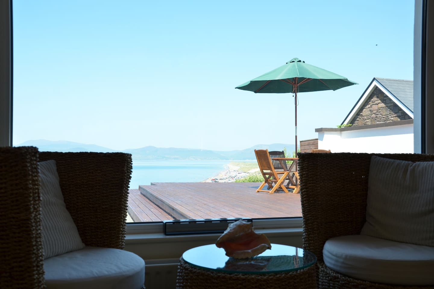 The stunning view from the sitting room past the decking area to the beach